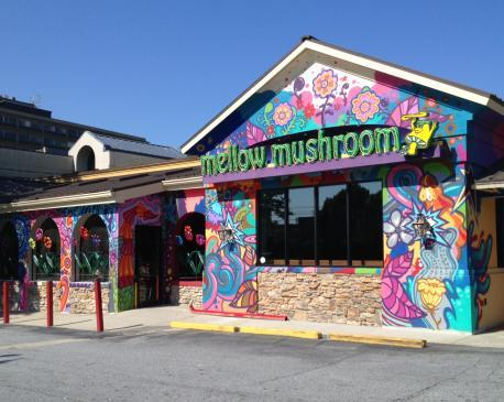 Mellow Mushroom is a funky, artsy chain pizzeria with handcrafted pizzas, calzones, craft beer, and more. The pizzas are stone baked and the restaurant offers standard topping as well as additional veggie toppings like broccoli.